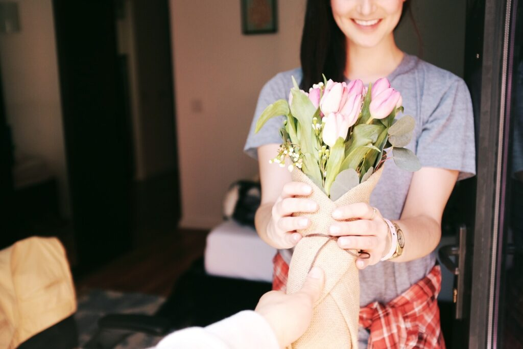 Giving tulips to a loved one